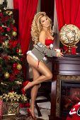 Sensual Blonde Girl In Santa Claus Costume