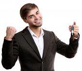 Businessman holding car key isolated on white