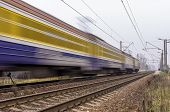 picture of passenger train  - Electric passenger train traveling on the railroad tracks - JPG