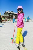 Skiing. Skier girl enjoying winter vacation