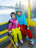 Skiing. Skiers in cable car