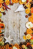 Dried fruits and christmas spices on wooden background, Christmas decoration