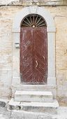 Wooden crumbling frontdoor.