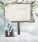 Empty wooden board with copyspace for text. Christmas concept with snowman
