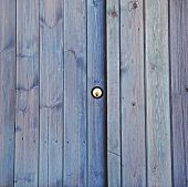 Lock on shed / garage door, property, exteriors, security or background.
