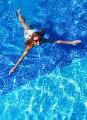 Beautiful woman in swimming pool. Relaxation.