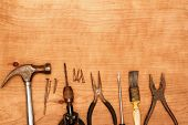 Assorted old work tools on wood