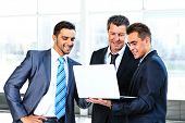 group of business people doing presetation with laptop during meeting