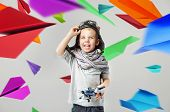 Young boy on paper airplane background