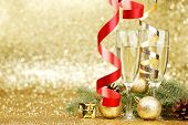 Champagne and christmas decor on glitter background