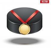 Sport gold medal with ribbon for winning ice hockey hangs on the puck