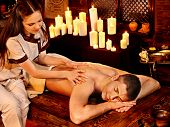 Young man having oil Ayurveda spa treatment.