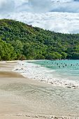 PRASLIN, SEYCHELLES - 21 OCTOBER 2014 - Busy Beach with People in the Water on Anse Lazio in Seychelles on 21 October 2014