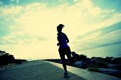 Runner athlete running at seaside. woman fitness silhouette sunrise jogging workout wellness concept