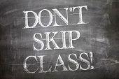 Don't Skip Class written on blackboard