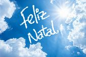 Christmas (Portuguese: Feliz Natal) written on a beautiful sky