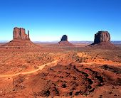 image of butts  - Rock formations knows as (left to right) West Mitten Butte East Mitten Butte and Merrick Butte Monument Valley Utah/Arizona United States of America.