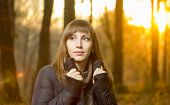 Portrait Of Young Beautiful Girl In Evening Autumn Forest