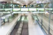 Blurred Image Of Escalator Walk Way In Airport Terminal.