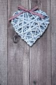 Decorative heart on a wooden background