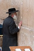 Jerusalem, Israel - March 14, 2006: Praying Men At The Wailing Wall In Jerusalem. A Man Dressed In A