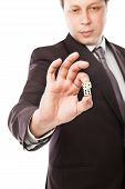 businessman throwing dices isolated on white