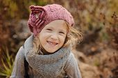 Portrait of happy child girl in autumn sunny day