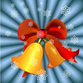 Christmas bells with red ribbon on blue rays background.