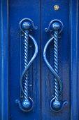 Gorgeous detail in handles of blue doors