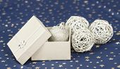 Christmas background with silver Christmas balls and gift box
