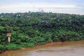 view of river Iguazu from international bridge between Brazil and Argentina