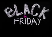Black Friday Advertisement Handwritten With Chalk On Blackboard