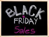 Black Friday Sales Advertisement Handwritten With Chalk On Wooden Frame Blackboard