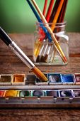Professional watercolor paints with artistic brushes