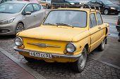 Yellow Soviet Zaz 968 Car Is Parked On The Roadside