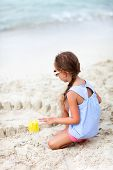 Back view of a little girl at beach during summer vacation