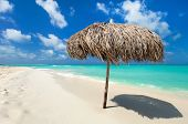 Tropical thatch umbrella on a beautiful Caribbean beach