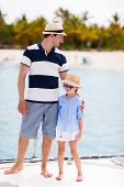 Happy father and his adorable little daughter outdoors sailing on yacht or catamaran