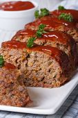 Sliced Meat Loaf With Ketchup And Parsley Close-up