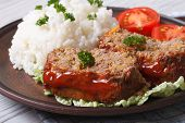 pic of meatloaf  - Delicious meatloaf with rice and tomatoes on a plate close - JPG