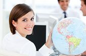 Smilling Businesswoman Holding A Globe