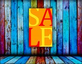 Sale Sign on Wood Background