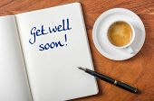 Notebook on a desk - Get well soon