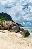 Close up Large Old Granite Rocks on White Beach Sand at Anse Source d'Argent in La Digue Island, Seychelles