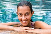 Close up Wet Smiling Indian Woman Leaning on the Pool Edge While Looking at the Camera.