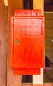 Red Wooden Postbox On The Wall.