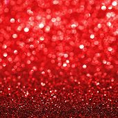 Red festive glitter background with defocused lights
