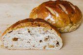 foto of whole-grain  - Fresh whole grain bread cut in half on cutting board - JPG