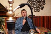 pic of shisha  - Person smoking hookah in the asian restaurant - JPG