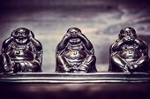 stock photo of philosophy  - Three figures of Buddha philosophy on wooden background - JPG